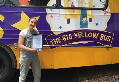 HVTC Allied Health Trainee Emma Williams standing in front of the Big Yellow Bus