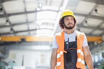 Young worker wearing protective clothing