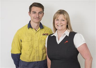 Young man in high vis clothing smiling with his mother