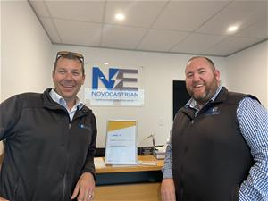 Two man standing in front of reception desk with Novocastrian Electrical sign in background