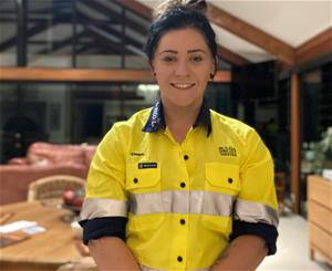 Young female in high vis workwear facing forward